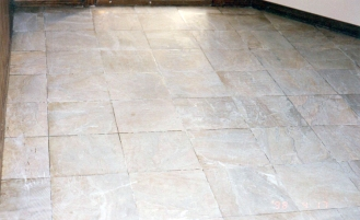 Marble surface worn out due to heavy traffic or improper use of chemicals